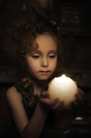 candlelight: Young beautiful, girl portrait by glow of candlelight Stock Photo