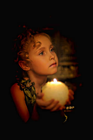 Young beautiful, girl portrait by glow of candlelight Stock Photo - 8716043