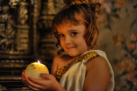 halterneck: Young beautiful, girl portrait by glow of candlelight Stock Photo