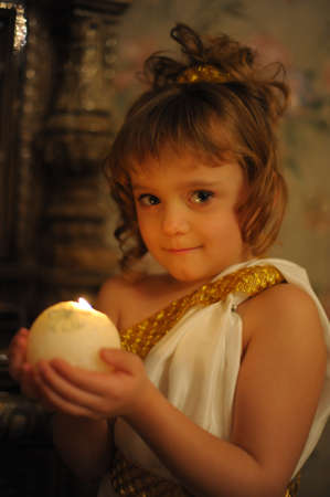 Young beautiful, girl portrait by glow of candlelight Stock Photo