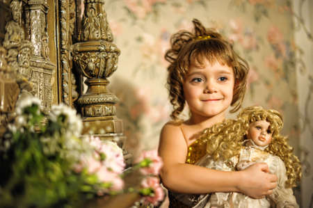 little girl with a doll in hands. Stock Photo - 8721911