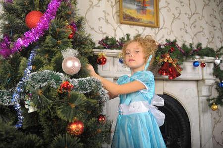 girl decorates the Christmas tree. Photo of retro style photo