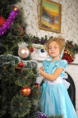 girl decorates the Christmas tree. Photo of retro style photo