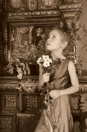 portrait of a girl with a bouquet of flowers photo
