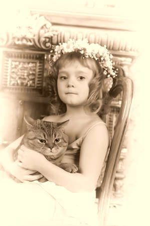 Girl with a cat in her arms Stock Photo - 9237079