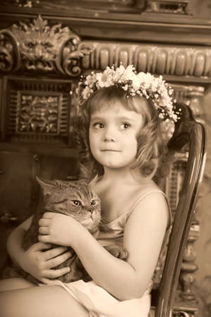 Girl with a cat in her arms Stock Photo - 9237083