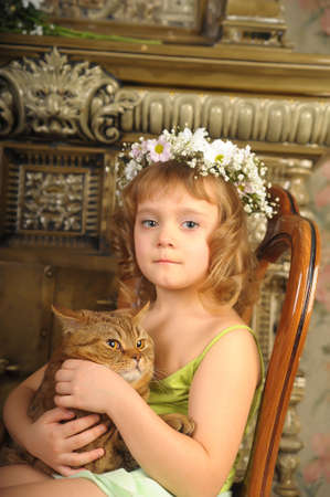 Girl with a cat in her arms Stock Photo - 9237081