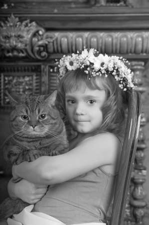 Girl with a cat in her arms Stock Photo - 9237085