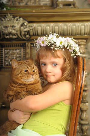 Girl with a cat in her arms Stock Photo - 9237087