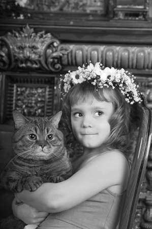 Girl with a cat in her arms Stock Photo - 9237088