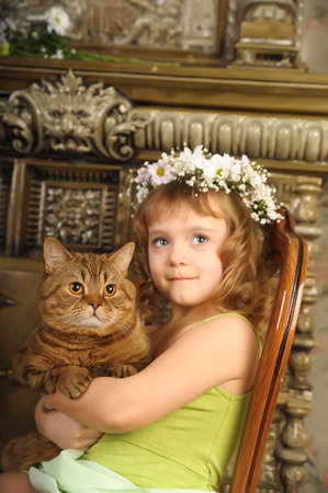 Girl with a cat in her arms photo