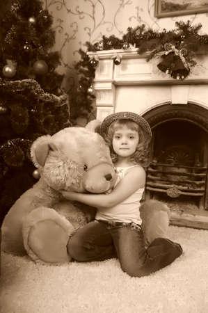 Girl with a big teddy bear photo