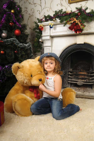 Girl with a big teddy bear photo