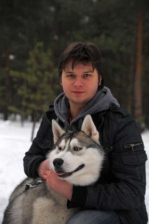 man with a husky photo