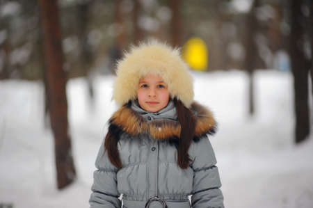 girl in a white fur hat photo