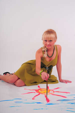 young woman paints photo