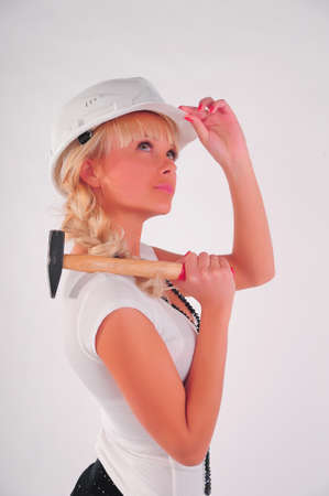 Architect with hammer photo