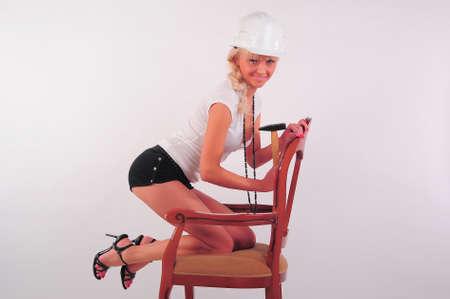 Woman hitting a nail Stock Photo - 8798737