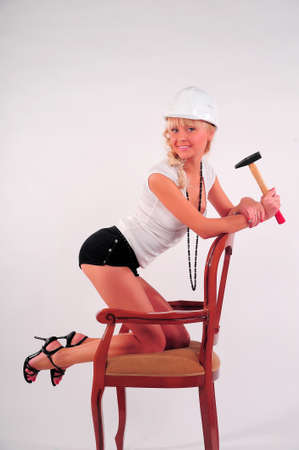 Woman hitting a nail Stock Photo - 8798979