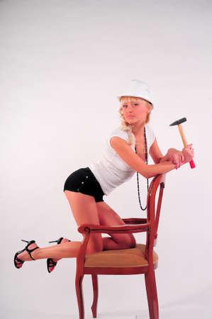 Woman hitting a nail Stock Photo - 8798914