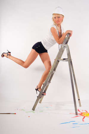 young woman on a stepladder photo