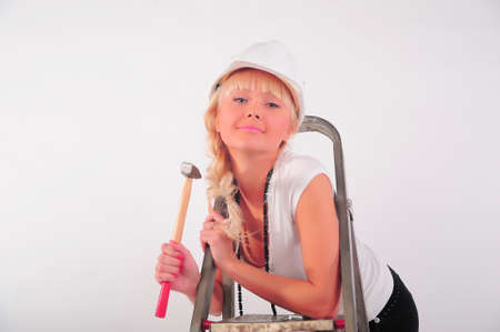 girl with a ladder and a hammer photo