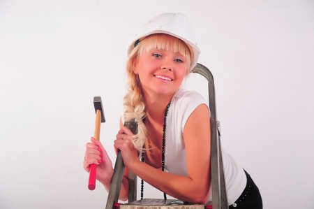 girl with a ladder and a hammer Stock Photo - 8798972