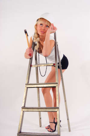 scaling ladder: girl with a ladder and a hammer