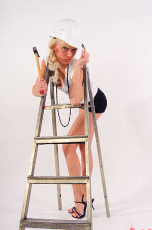 girl with a ladder and a hammer Stock Photo - 8798901