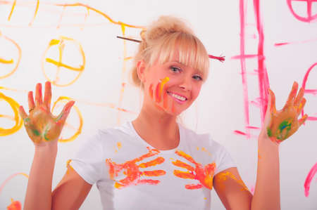 beautiful young woman and paints photo