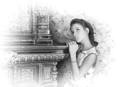 girl with retro hairdo about antique stove Stock Photo - 13728004