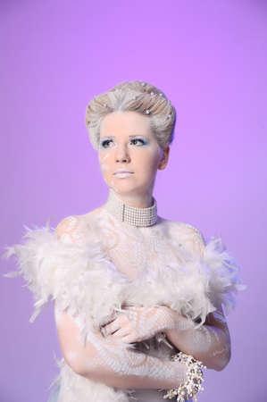 Blond model wearing white boa photo