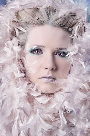 Blond model wearing white boa photo