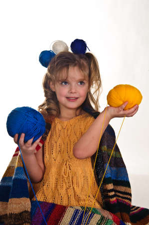 little girl with lots of balls of wool Stock Photo - 8934644