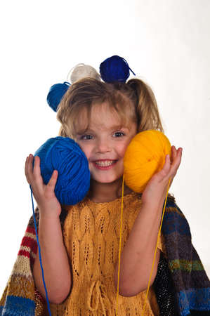 little girls play with balls of wool Stock Photo - 8934637