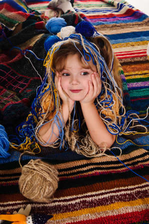little girls play with balls of wool photo