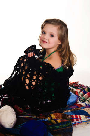 Girl wrapped in a knitted shawl photo
