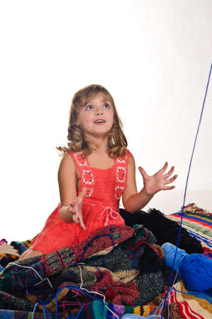 Girl playing with balls of wool photo