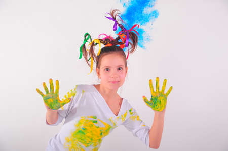 Girl with hands soiled with paint photo