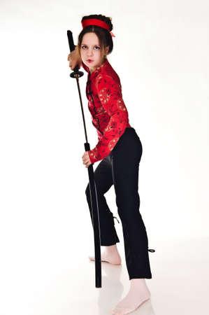 A girl handling a long samurai sword photo