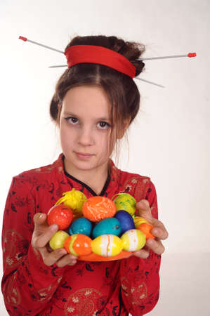 Japanese girl with Easter eggs Stock Photo - 9000098