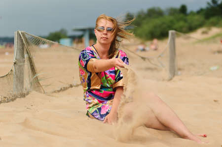 she poured the sand out of the hands photo