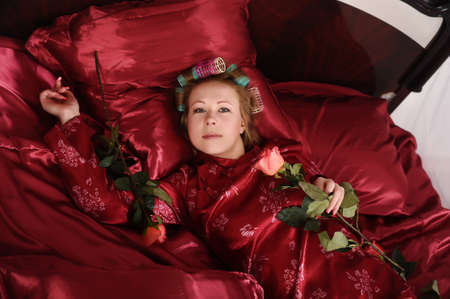 young woman lying on a bed photo