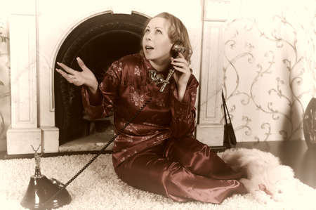 woman speaking on the phone photo