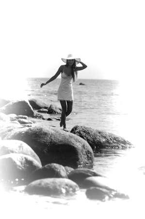 girl walking on the stones photo