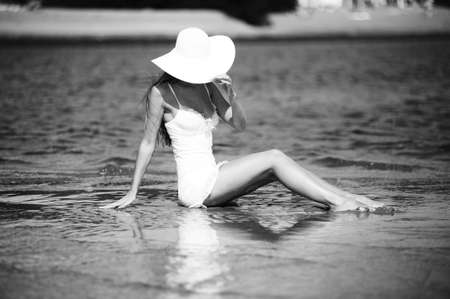 Attractive young female wearing a straw hat photo