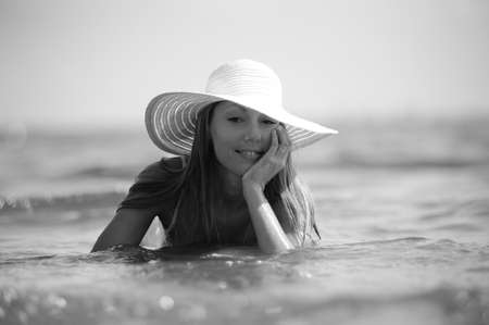 Attractive young female wearing a straw hat Stock Photo - 9215928