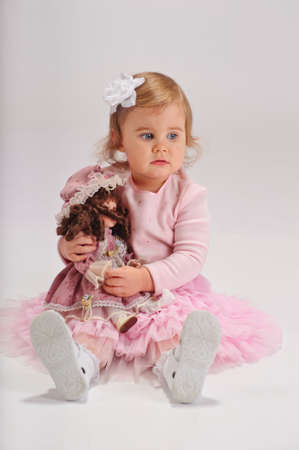 little girl with a doll photo