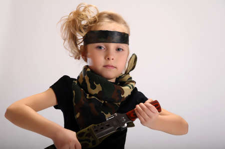 toddler girl with an army knife photo