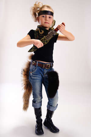 toddler girl with an army knife Stock Photo - 9045477